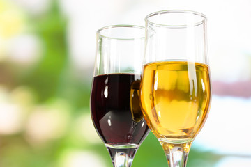 Wine in glasses on nature background