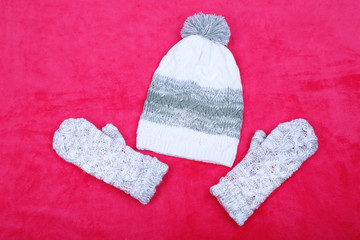 Winter cap and gloves,  on color background