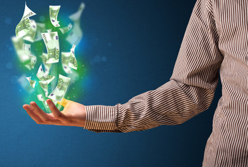 Glowing money in the hand of a businessman