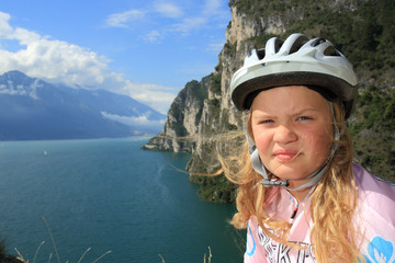 young biker girl with Lake Garda panorama