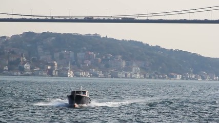 Boat on the Bosphorus under a bridge