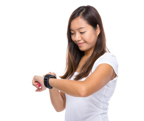 Woman look at her smart watch for heart beat rate