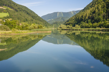 Mountain mirroring in the river Enns in Upper Austria