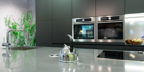 detail over work plate of modern kitchen with teapot