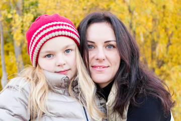 Mother and daughter in autumn