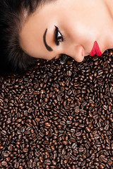 face of a beautiful woman in coffee beans