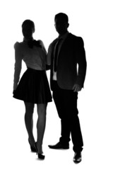 Stylish couple standing side by side
