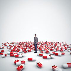 man standing among pills