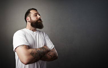 tattooed brutal man wearing white t-shirt