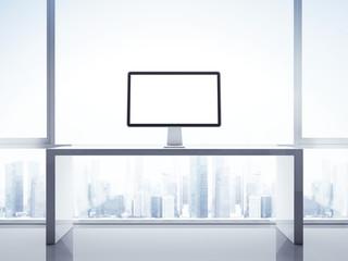 Computer display on a table