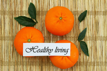 Healthy living card with mandarines on bamboo mat