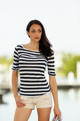 Woman in stripes glancing away from camera