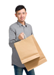 Asian man hold with shopping bag