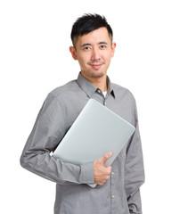 Asian man with laptop computer