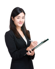 Asian business woman write on clipboard