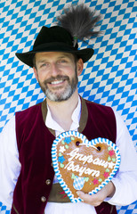 bavarian man with gingerbread heart