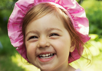 Summer portrait of adorable little baby girl laughing