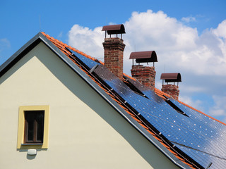 Reconstructed house with solar panels on the roof.