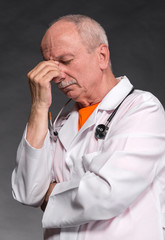 Tired medical doctor with stethoscope