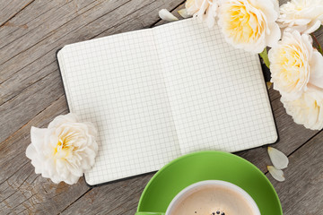 Blank notepad, coffee cup and white rose flowers