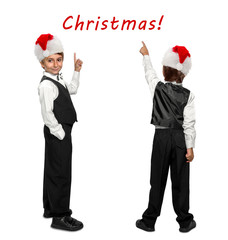 little boy in a tuxedo and  in Santa Claus xmas red hat pointing