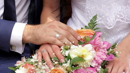 hand the bride and groom on a wedding bouquet