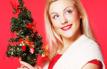 woman holding Christmas tree