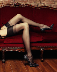 Beautiful long legs  in erotic black stockings