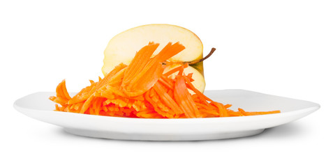 Half An Apple With Grated Carrot On White Plate