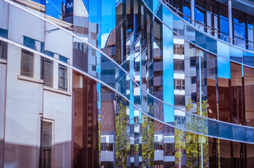 Buildings reflected in windows of modern office building