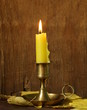 canvas print picture - vintage candlestick with candle on the wooden background