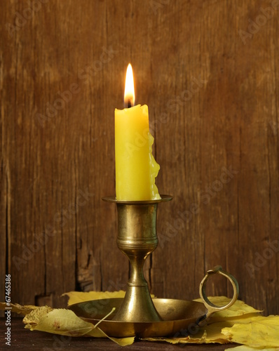 canvas print picture vintage candlestick with candle on the wooden background