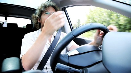 Man complaining about traffic in car