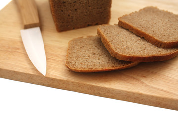 Rye sliced bread on the wooden desk with knife