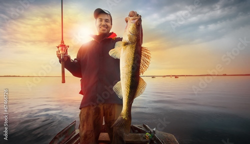 Happy angler with zander fishing trophy - 67466726
