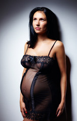 sensual pregnant woman in nightie