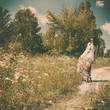 walking on the meadow, retro styled female portrait