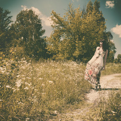 walking on the meadow, retro styled female portrait