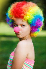 little girl in clown wig