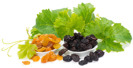 Bowls of colorful raisins with leaves of grape