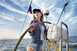 Woman steering yacht a