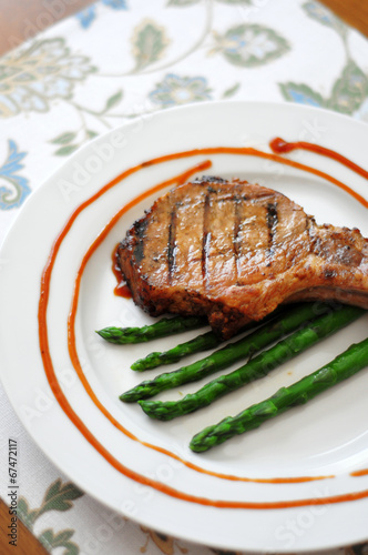 Grilled porkchop with asparagus and bbq sauce