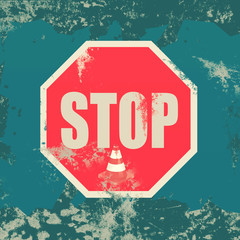 Stop sign on grunge background