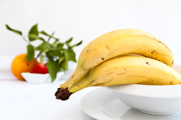 Bananas on white plate