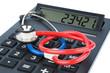 Stethoskop und Taschenrechner