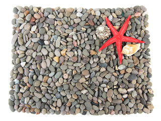 Small sea stones and sea star isolated on white