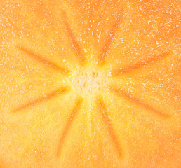 Cut persimmon on pieces close up