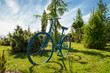 Decorations in park .blue bicycle