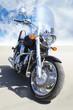 motorcycle on asphalt against  sky