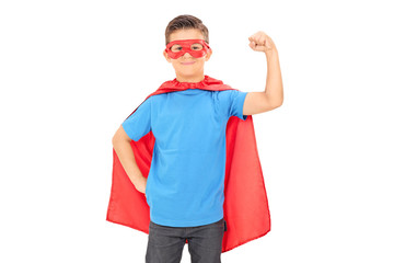 Junior superhero holding his fist in the air